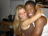 Blonde gets a bit flirty with black guy at party.